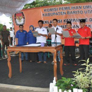 Photo : Pasangan Calon Bupati dan Wakil Bupati Barito Utara Saat Penandatanganan Dan Pengucapan Ikrar Deklarasi Kampanye Damai